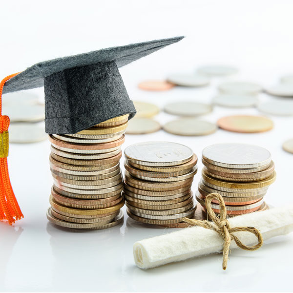 stacks of coins with small cap and diploma